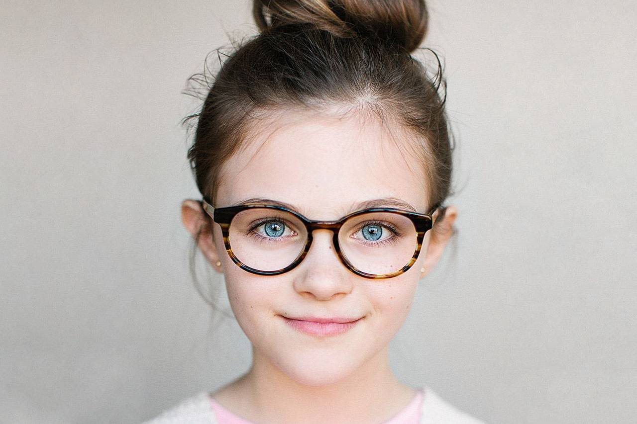 blue eyed tween girl with glasses